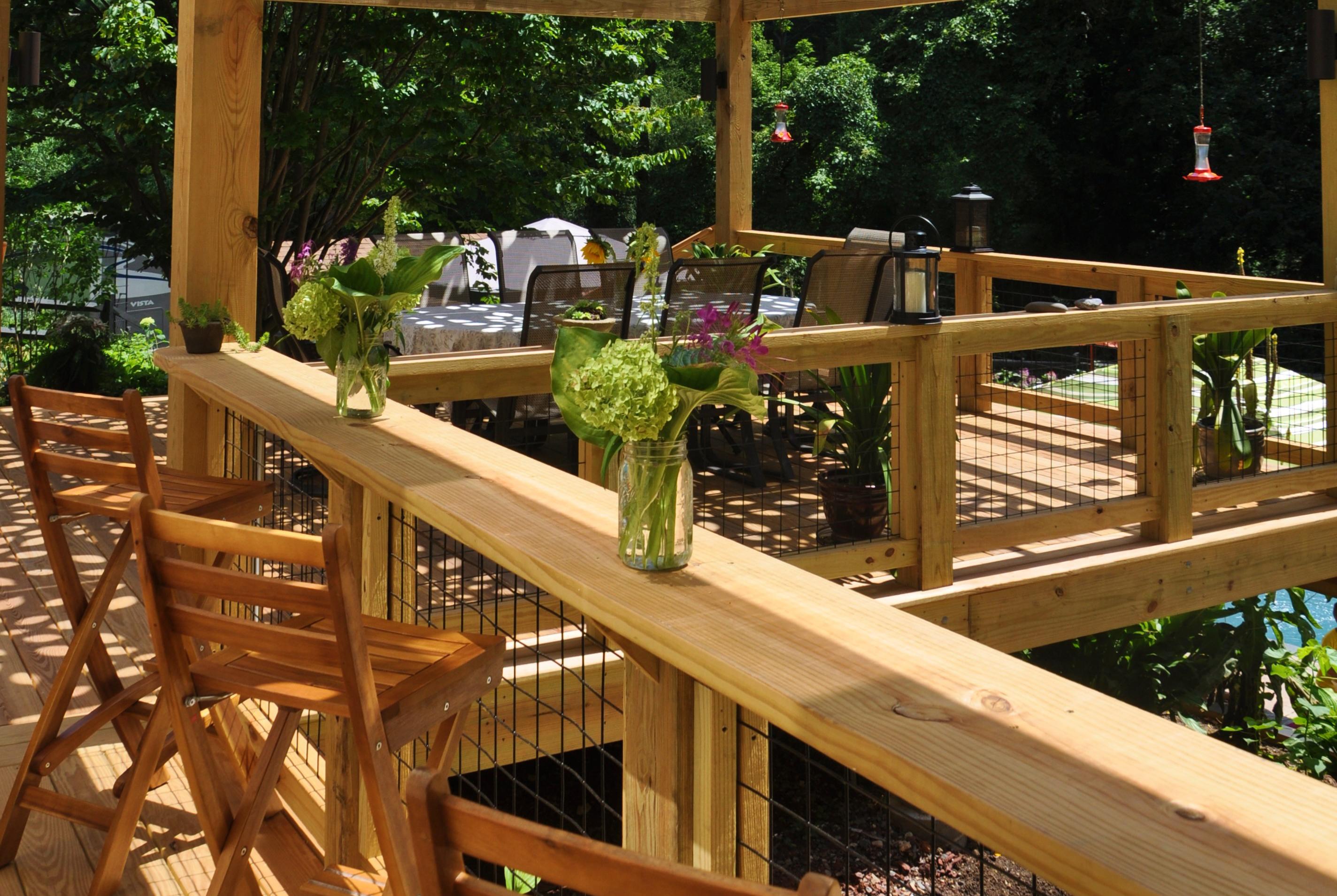 Autumn leaf pergola professional deck builder design for Decking at end of garden