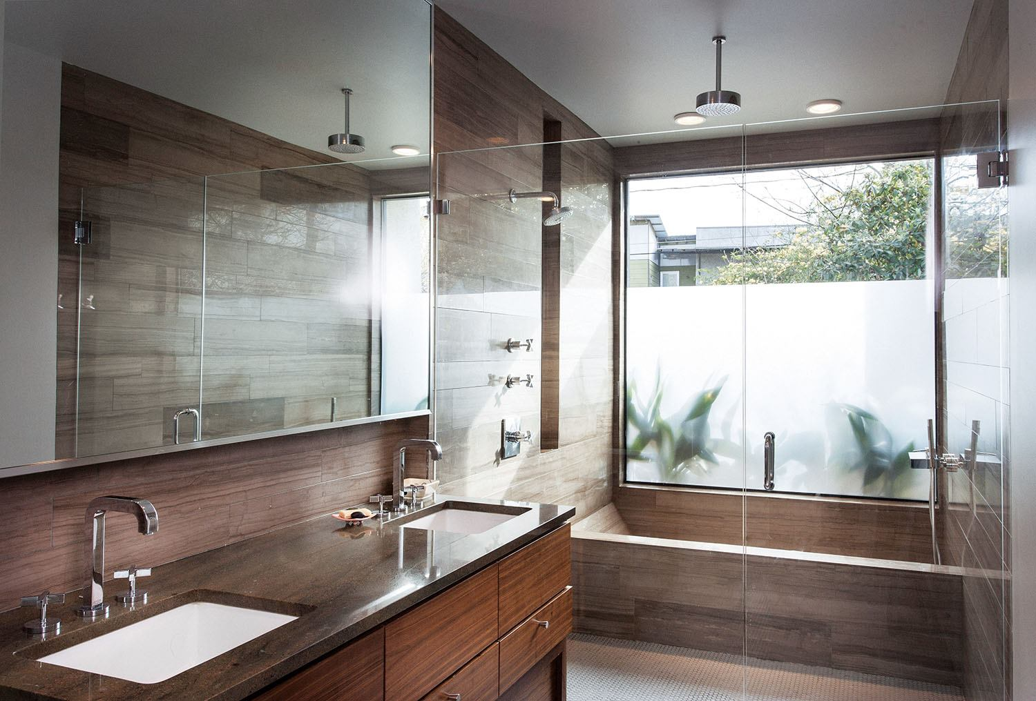 A luxurious master bath graces a compact infill house - Bathroom designs for home ...
