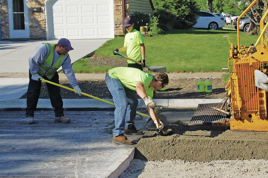 Roller Compacted Concrete Specifications : Suburb self performs rcc public works magazine roller