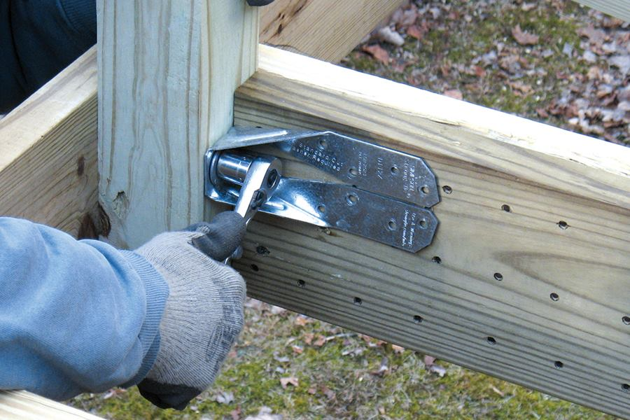 how to secure a 4x4 post to a deck