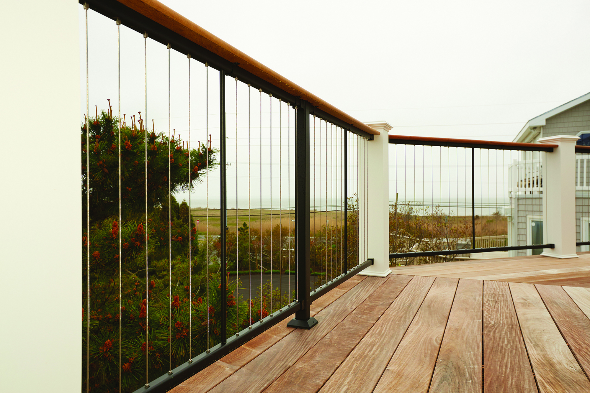vertical cable rail professional deck builder fencing. Black Bedroom Furniture Sets. Home Design Ideas