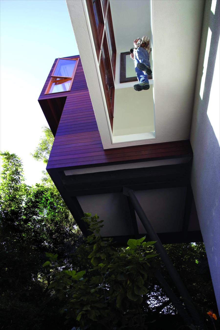 A floor window captures the view below remodeling for Frazer crane architect