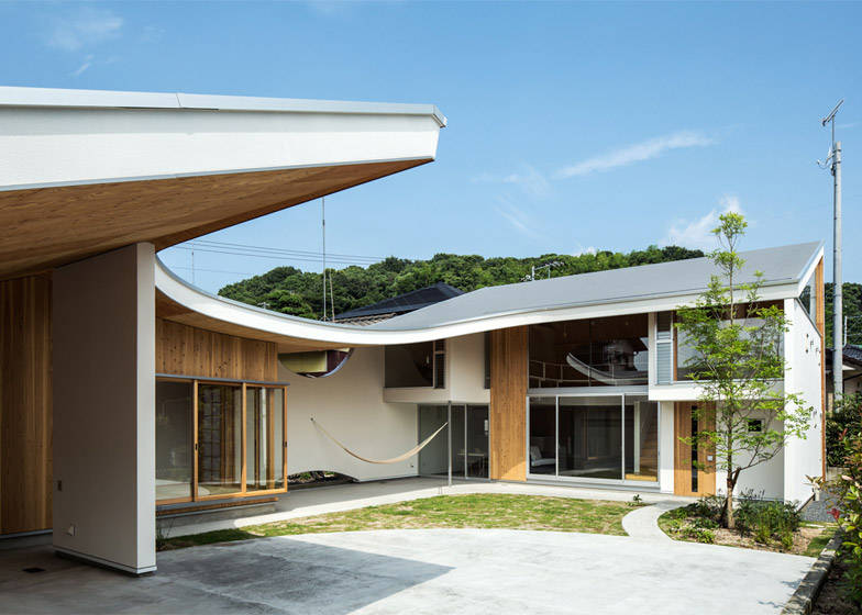A Japanese Shawl House With A Curved Roof And Perfect