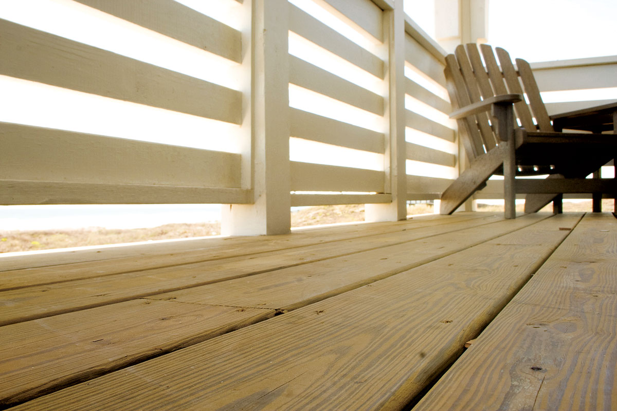 Lumber life cycle wood vs composite decking remodeling for Cost of composite decking vs pressure treated