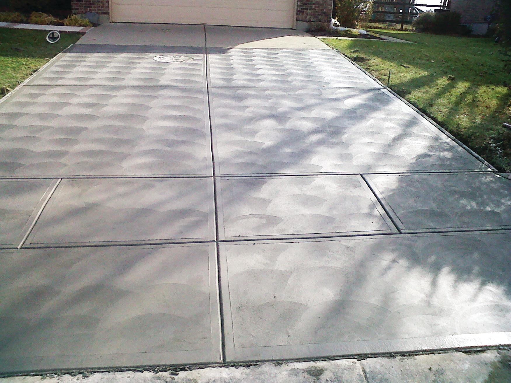 Driveway finish trends concrete construction magazine for What is the best way to clean concrete