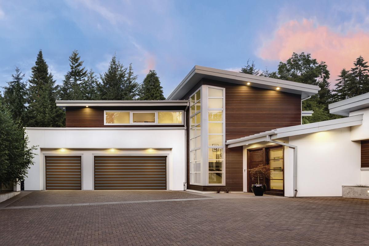 Clopay's Modern Garage Doors Both Shield And Impress
