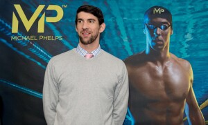 US  swimmer and Olympic champion Michael Phelps speaks at a press conference as part of the ISPO sporting equipment trade show in Munich, GermanyFriday Feb. 6, 2015. In conjunction with the manufacturer Aqua Sphere, Phelps is presenting his own range of swimming equipment at the show. (AP Photo/dpa,Sven Hoppe)