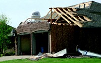 Major windstorms impose extremely high wind pressures on garage doors. If the doors cave in, the house blows up like a balloon and can burst at the seams that hold down roofs and walls.