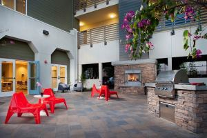 The courtyard at the development provides outdoor space for the residents, including a built-in barbecue for community gatherings. The property also includes a large community room, a computer lab, a lounge with games and a TV, and community gardens.