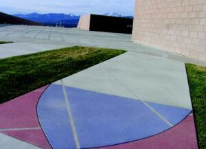 Discovery Canyon Middle School, Academy School District 20, Colorado Springs, Colo. Colorado Hardscapes, Denver Topical blue, red, gold, and turquoise stain illustrates DNA strands in the Proto Plaza section.