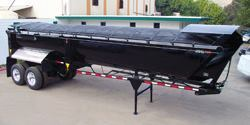 Suitable for long bodies, cable systems position the tarp on a series of bows. A cable below the top rail slides the tarp and bows back and forth along the top of the body.