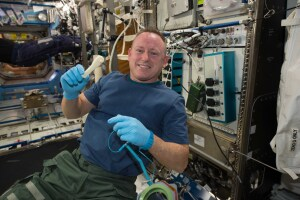 "International Space Station Expedition 42 Commander Barry ""Butch"" Wilmore shows off a ratchet wrench made with a 3-D printer on the station. (Photo by NASA)"