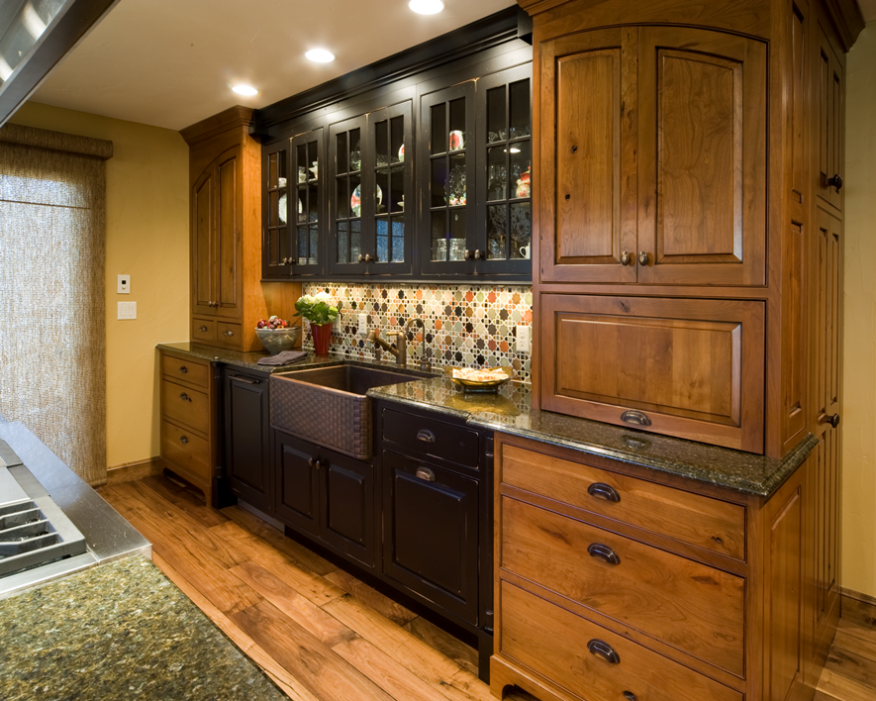 Doug Walter used LEDs in three 5-inch recessed cans and bright undercabinet lighting over the sink; due to the kitchen's dark finishes, more lighting was needed to achieve the recommended levels.