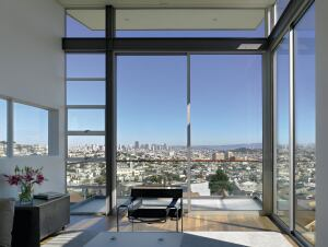 The home features a scenic view of San Francisco and an open floor plan.