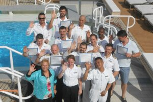 Graduates of a CPO course taught by Connie Sue Centrella (front, far left) gather on the deck of the Azamara Quest in the Greek islands. (photo courtesy C.S. Centrella)