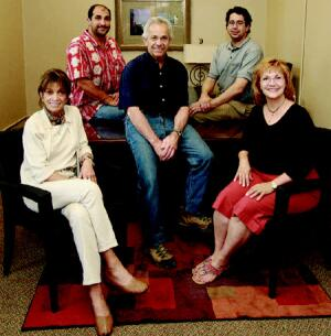 The Minervini Group, left to right: Mini Minervini, Tony Lombardi, Ray Minervini, Raymond Minervini, and Marsha Minervini photographed in the new company offices on the first floor of Building 50 at The Village.