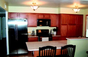 Once the design is complete and the products delivered, Amberson Cabinet can complete a kitchen remodel within one week. The project above includes new cabinets, countertops, appliances, and a sink and faucet.