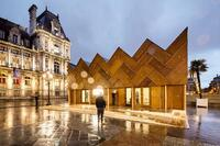 A Wooden Crown Pavilion Made From Construction Waste