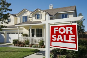 Home For Sale Sign in Front of New House.; Shutterstock ID 39571219