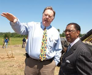 "Baton Rouge (La.) Deputy Public Works Director Bryan Harmon (left) and Mayor ""Kip"" Holden tour the site of a thruway that will link Baton Rouge with the city of Central, a $70 million project encompassing nine separate projects. The improvements also provide a flood evacuation route. Photo: David Humphreys"