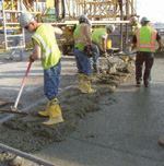 Pouring a precast structure with only macro-synthetic fibers as the reinforcement.