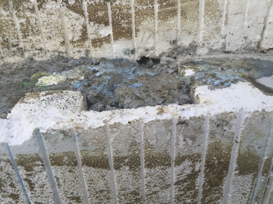 In addition, small air pockets and sloughed concrete was evidence that the pour had not been ideal.