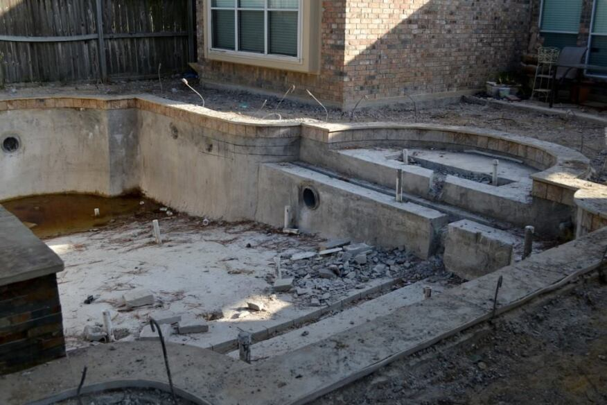 Pool undone: The Comeauxs' installation before Cody Pools took it on. The rubble is from Bellar Pools' attempt to saw the floor so crews could lay plumbing that had not been placed, sources said.