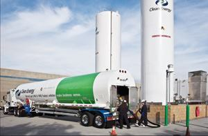 A truck delivers liquefied natural gas (LNG) to a refueling facility.