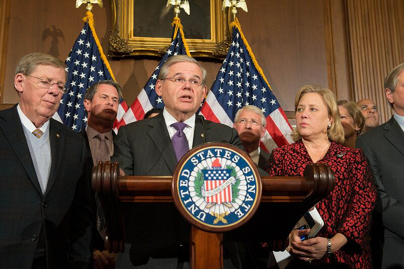 Senate Democrats speaking at a podium.