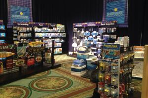 Shelf space: At PoolCorp's model pool store, the mix of pool and spa products were presented with a clean look, and each product had a QR code attendees could scan to learn more.