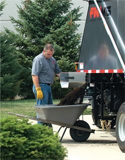 Smaller doors or chutes are often located on each side of a material transfer system's trailer. The user can pull up a wheelbarrow, open the door, and push a button to unload the material in a few seconds.