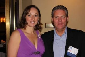 New Master Pools Chairman of the Board Carla Sovernigo-Pawella of Alka Pool Construction in Vancouver, British Columbia, appears with former Chairman Brad Cotton of Mission Pools, Escondido, Calif.