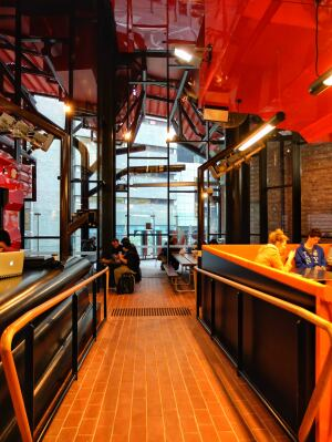A laneway-inspired room inside the RMIT Swanston Academic Building by Lyons Architects: architectural space becomes urban.