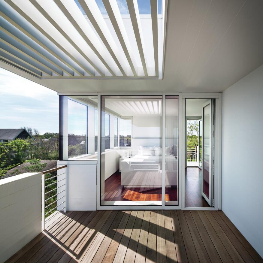 A deck outside the bedroom is one of many in and around the house—there are 1,700 square feet of decks in all, almost doubling the house's footprint.