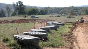 In Virginia, Loudoun Water (formerly the Loudoun County Sanitation Authority) approves all specifications and plans for community-based systems in new developments. The developers then deed the systems to Loudoun Water to own and operate. The agency relies heavily on natural wastewater treatment, such as septic tanks, drip irrigation, and recirculating sand filters, which are shown here. Photos: Loudoun Water