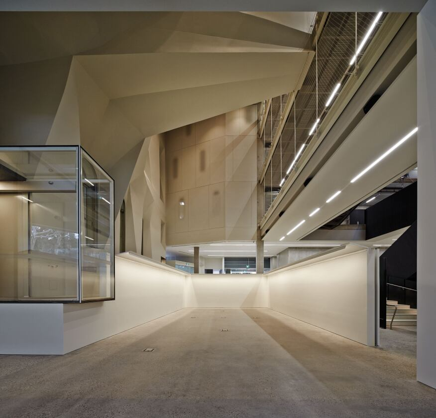 To finish the exposed concrete to pristine smoothness, the architects turned to products like Renderoc.