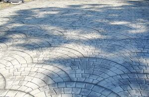 This fish-scale finish has become popular as a stamped-concrete option for customers at Edwards Concrete.