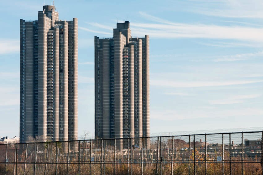 More than 150 multifamily projects were constructed under the 1955 Mitchell- Lama housing program, including the Tracey Towers in the Bronx, N.Y. This project only exemplifies the type and age of buildings that may be included in the RetrofitNY initiative; no specific list of RetrofitNY projects was available at the time of this article's publication.