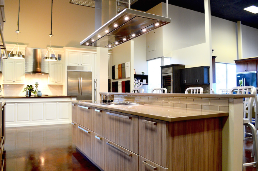 The showroom contains fully functional kitchen vignettes in various styles.