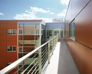 "good cover  For timeless and enduring exteriors, Reatig turns to Trespa wood fiber and resin panels. In addition to the product's durability, the architect appreciates ""its high quality"" and ""its large selection of vibrant colors."" The panels shown here are on one of the firm's multifamily projects. Trespa North America, 800.487.3772; www.trespa.com."