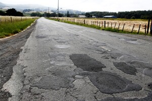 Patches on top of patches covering potholes litter a road in Sonoma County, California, May 9, 2013. Harrison, a local resident and attorney, is part of a grass-roots campaign to fix the crumbling roads of Sonoma County, which is struggling with the same type of government financial crisis that has driven California cities such as Stockton and San Bernardino into bankruptcy. Picture taken May 9, 2013.   REUTERS/Beck Diefenbach   (UNITED STATES - Tags: BUSINESS TRAVEL) - RTX1053C