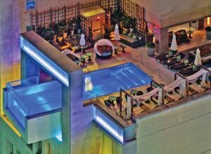 A facility most benefits the population when local culture is incorporated into its programming and aesthetics, as seen with this pool at Dallas' Joule Urban Resort.
