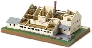 "A completed model of a farmhouse printed with the new ZPrinter 450 shows off the machine's ability to print in full color and print patterns imported from image files (note the ""stone"" chimney)."
