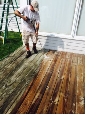 Careful pressure-washing with a Jomax-and-bleach solution removed mildew and dirt from the decking.