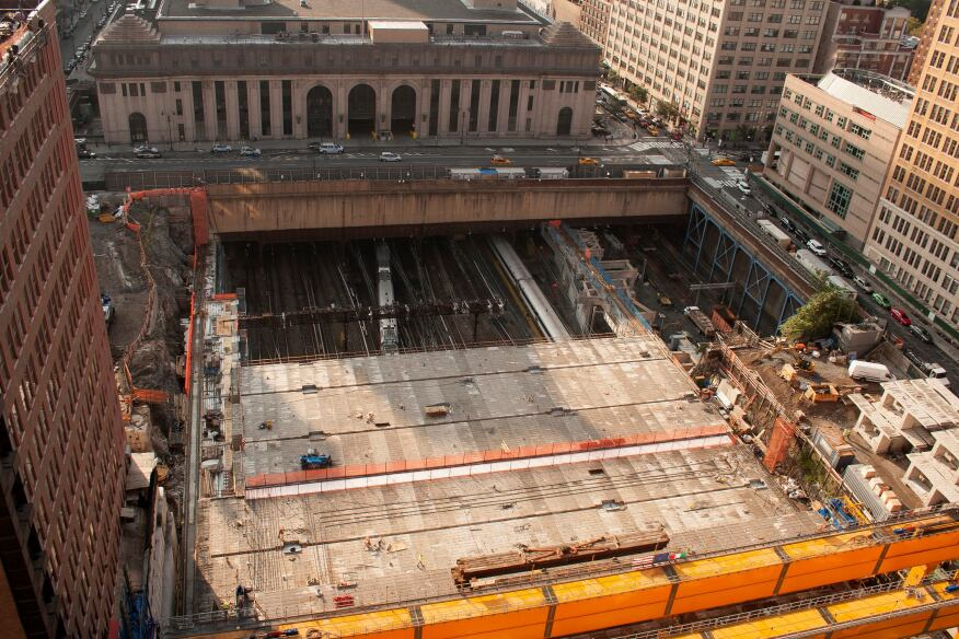 The under-construction platform for the Manhattan West mixed-use development project at Ninth Avenue and 33rd Street in New York. The platform is being constructed over existing an Amtrak rail yard. Skidmore, Owings & Merrill is the master plan architect for the Manhattan West project, and James Corner Field Operations is the landscape architect.
