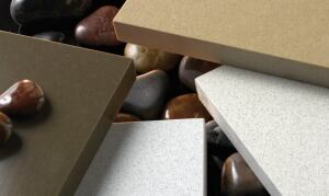 concrete addition DuPont Zodiaq debuts four colors (alabaster, sand beige, clay brown, and papyrus) that provide the aesthetic of concrete with the easy care of quartz. A matte finish with a monolithic appearance makes these colors a good fit for contempo