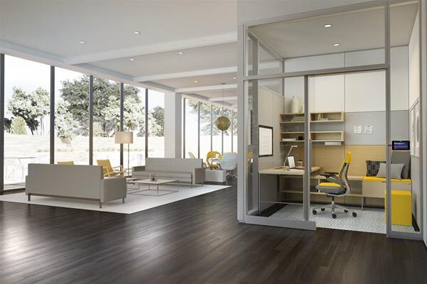 Flow, a workspace module from Steelcase designed in collaboration with author Susan Cain, houses seating, desk space, and integrated media behind a wall of privacy glass. The latter feature is not shown in this image.