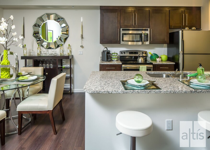 Altis at Sheridan features open living–dining–kitchen floor plans. The
