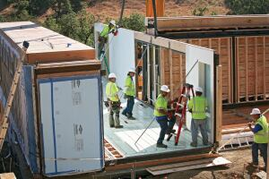 Labor Dispute. Workers assemble a home made from modules produced by Blu Homes, the California-based manufacturer that has run afoul of Carpenters Union Local 180, which accused the company of unfair labor practices.