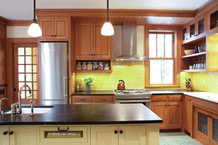 Artful Craftsman Soapstone Counters, a Tile Backsplash, and Oak Cabinets Strike a Balance Between Traditional and Fresh.